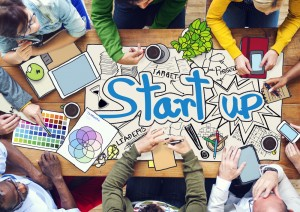People Working with Photo Illustrations of Startup Business